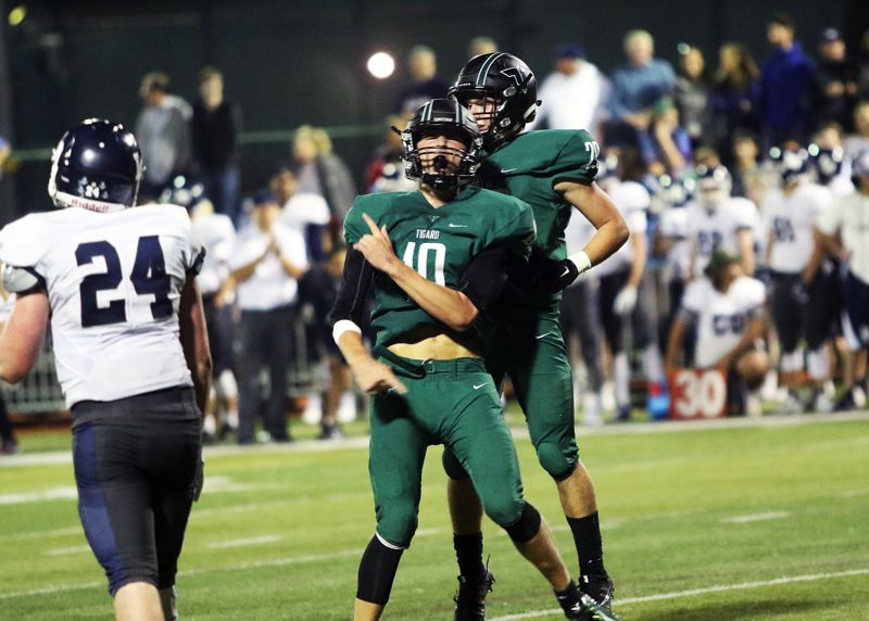 DAN BROOD - Tigard senior quarterback Nick Heinke lets out a yell after throwing the game-winning touchdown pass in the Tigers' 31-28 victory over Lake Oswego.