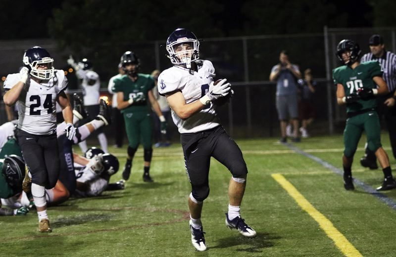 DAN BROOD - Lake Oswego sophomore Casey Filkins scores his second touchdown of the night.