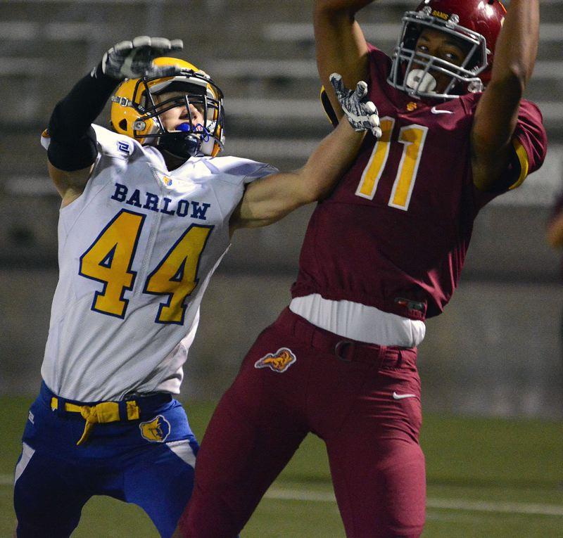 OUTLOOK PHOTO: DAVID BALL - Central Catholic receiver Silas Starr pulls down a touchdown grab over Barlow's Nick Collins to give the Rams a 34-7 lead midway through the third quarter.