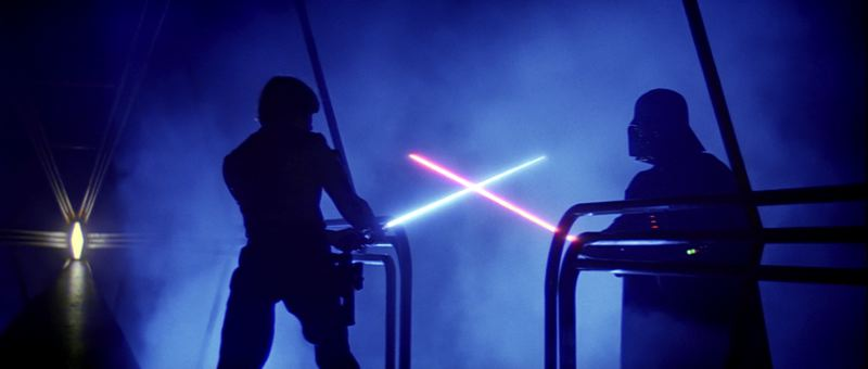 COURTESY: LUCAFILM/ILM - Not your father's visual effects: Luke and Darth face off with lightsabers in Star Wars. In The Return of the Jedi Kuran figured out how to make the colors of the lightsabers stand out, a technique he later used in fixing colors on ageing film.
