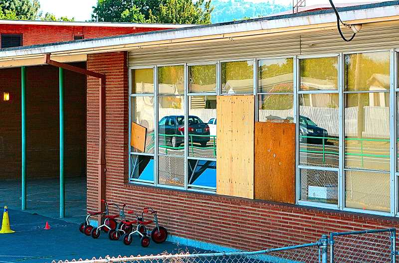 DAVID F. ASHTON - At Whitman Elementary School, these are some of the many windows shattered during the vandalism spree