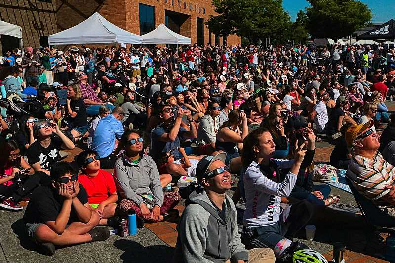 DAVID F. ASHTON - During the nearly total solar eclipse at OMSI, the light changed more toward the blue part of the spectrum and the sky darkened, many sat silently watching, while others responded with delighted laughter, and some wept openly.