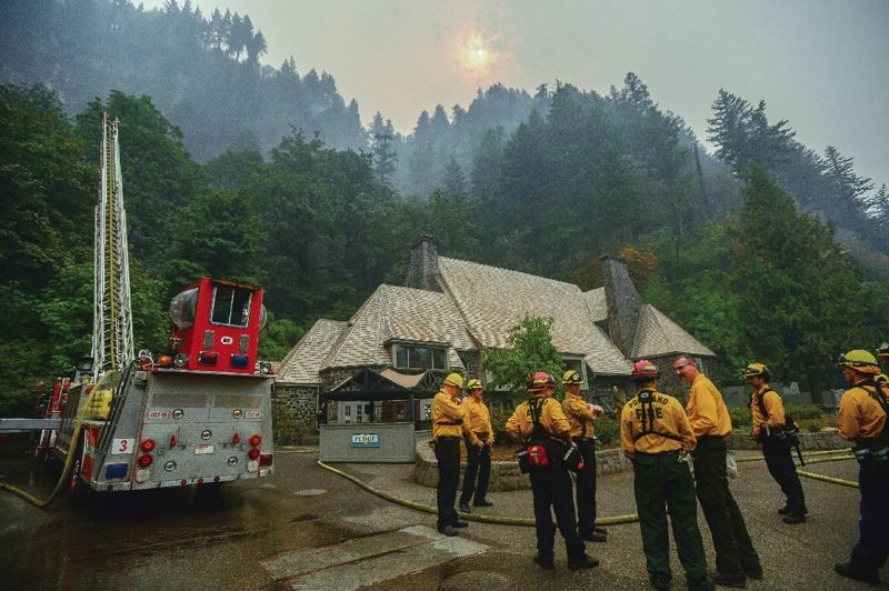 PHOTO BY: JOSH KULLA - Firefighters take a break earlier this month from the effort to protect the historic Multnomah Falls Lodge from the expanding Eagle Creek Fire.