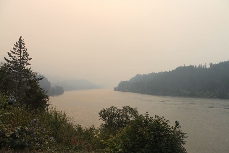 TRIBUNE PHOTO: LYNDSEY HEWITT - The Columbia River Gorge was still extremely smoky on Saturday, and drifted into Portland. Rain will help contain the fire, but poses other dangers — such as flash floods.