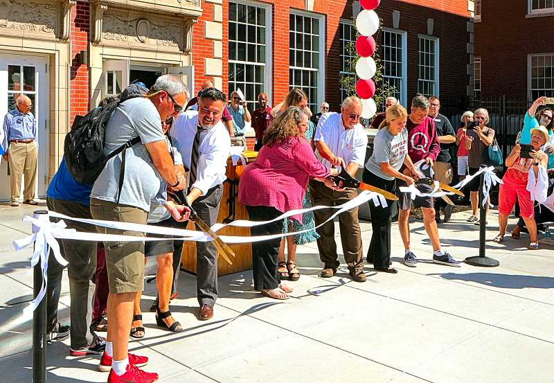 DAVID F. ASHTON - Wielding giant scissors, FHS alumni, staff, and dignitaries snip the ribbon - officially dedicating the renovated high school.
