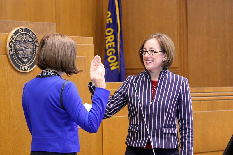 SUBMITTED PHOTO - Oregon Gov. Kate Brown administers the oath of office to state Rep. Andrea Salinas on Monday  on the floor of the Oregon House of Representatives in Salem.
