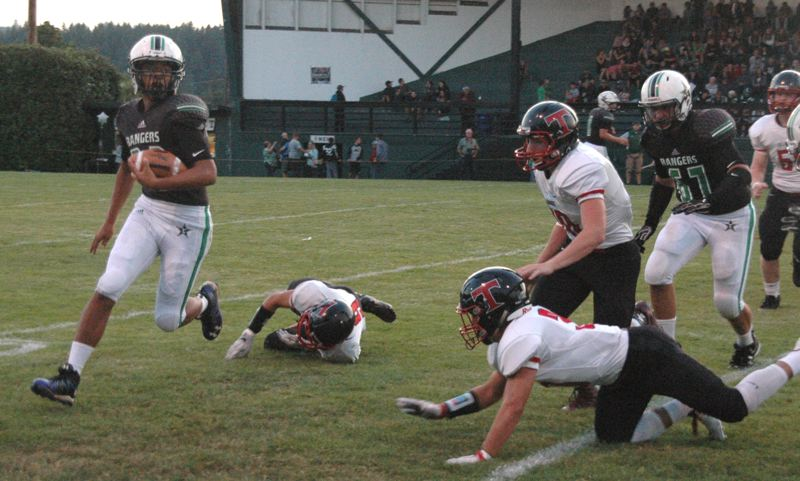 CONTRIBUTED PHOTO: MIKE WEBER - Estacada running back Gabriel Martinez looks to get around the corner during last Fridays 22-16 win over Tillamook.