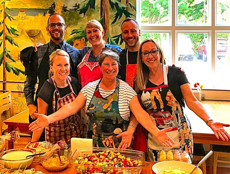 Shown are the John L. Scott Woodstock agents who volunteered to cook on August 29 at the nonprofit Ronald McDonald House. Front row, from left: Trisha Highland, Lisa Smillie, and Michelle Maida; back row, from left: Anthony Carnivale, Claudie Smith, and Alex Roy.