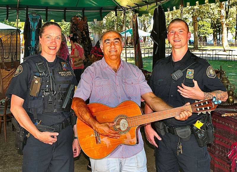 DAVID F. ASHTON - Central Precinct Police Officer Caroline Greulich meets the author of the book The Traveler - who is also a musician, and a Palestinian from East Jerusalem, Mohammad Bader - as also does Officer Michael Greenee.