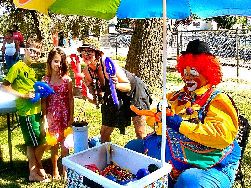 RITA A. LEONARD - Liam, 9, and Layla, 6, received balloon sculptures created by Laura Panda and clown Gentle Biff.