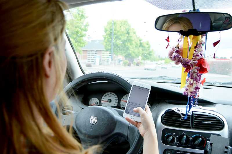 PMG FILE PHOTO - Beginning Oct. 1 Oregon will institute a new hands-free law that expands and clarifies the state's current prohibition on electronic device use while driving.
