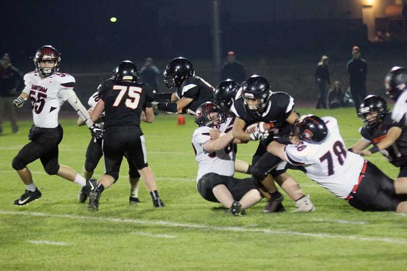 WILL DENNER/MADRAS PIONEER - Culver junior Victor Torres (center) scored a 13-yard rushing touchdown for the Bulldogs, part of his 141 yards gained, but it was the only score of the night the team could muster. Turnovers plagued Culver and led to easy points for Santiam in a 51-6 win.