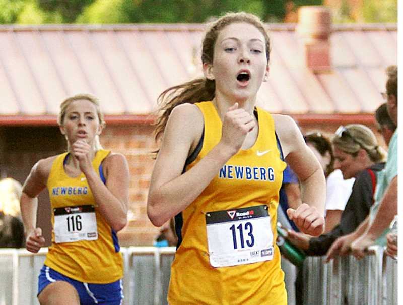SETH GORDON - With teammate Savanna Salmons just behind, Abi Hein pushes to finish the course at Sherwood High School Sept. 13. Hein and Salmons finished 2-3 to lead the Tigers to wins over Lakeridge and Sherwood.
