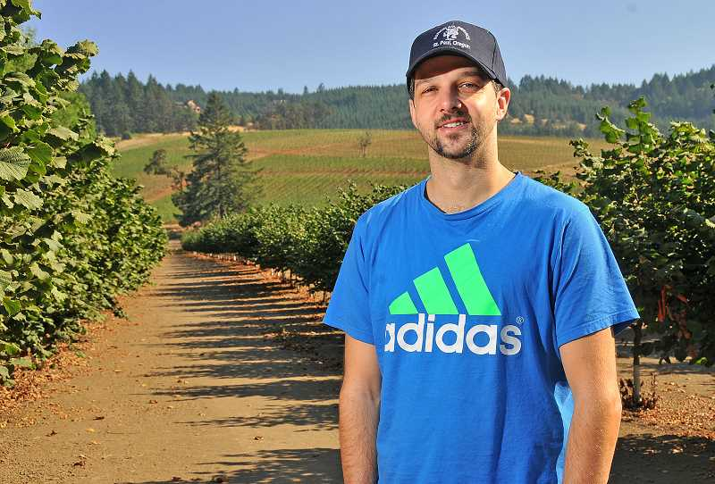 SPOKESMAN PHOTO: VERN UYETAKE - Christian Richmond, a third-generation hazelnut farmer, came back to the family business shortly after finishing law school.