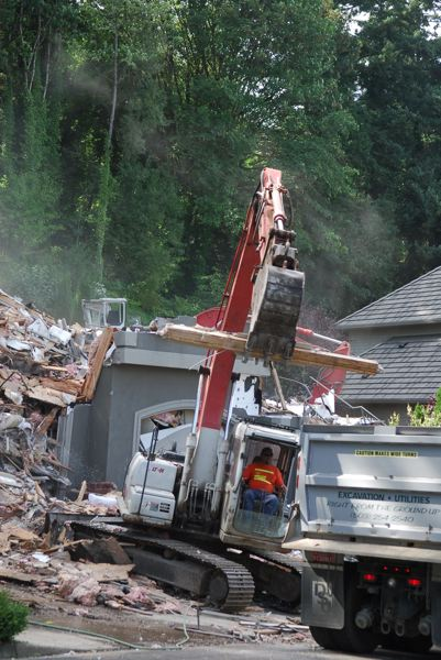 PORTLAND TRIBUNE FILE PHOTO - Some people fear lead paint chips can become airborne when houses are demolished and drift onto nearby properties, including where children play outside.
