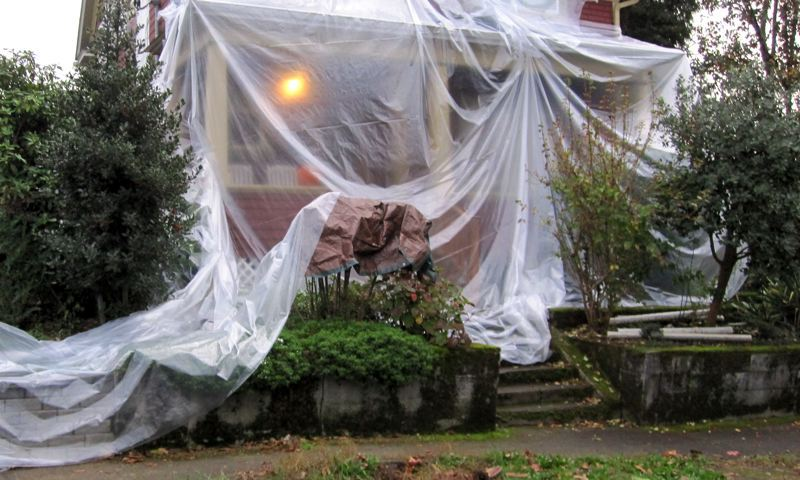 PAMPLIN MEDIA GROUP: DAN FORBES - Demolition of some older homes in Portland could change under a proposed ordinance being circulated by City Commissioner Chloe Eudaly. Here, a home has been partially wrapped in plastic in an attempt to mitigate the spread of lead dust.