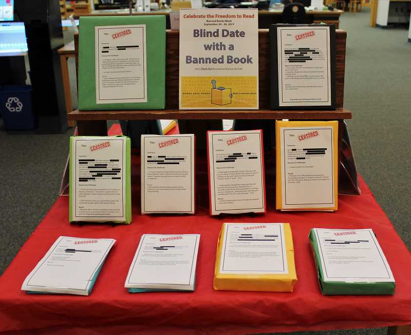 SPOKESMAN PHOTO: CLAIRE GREEN - Through the Wilsonville Public Library's program Blind Date with a Banned Book, patrons are invited to select a wrapped book based on a summary and reason for why it was challenged.