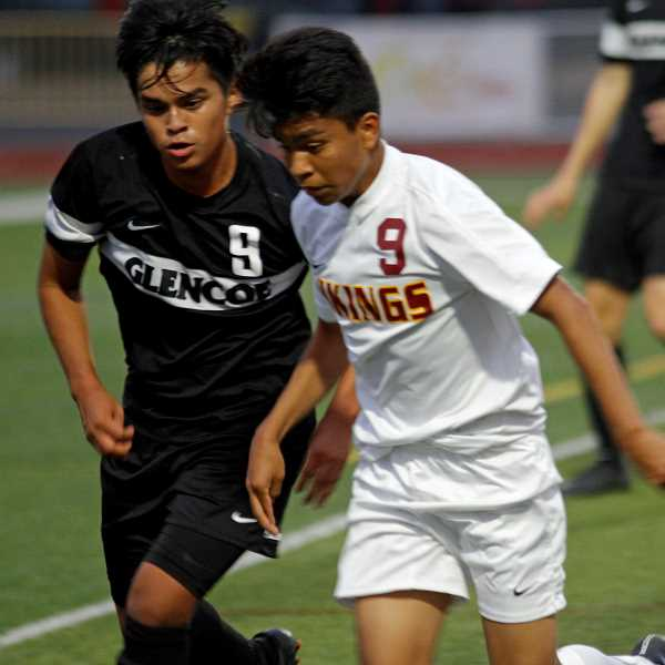 HILLSBORO TRIBUNE PHOTO: WADE EVANSON - Glencoe junior midfielder Sergio Tapia-Rodriguez fights for a ball with a Forest Grove defender during the Tide's 3-2 win over the Vikings Sept. 14 at Forest Grove High School.