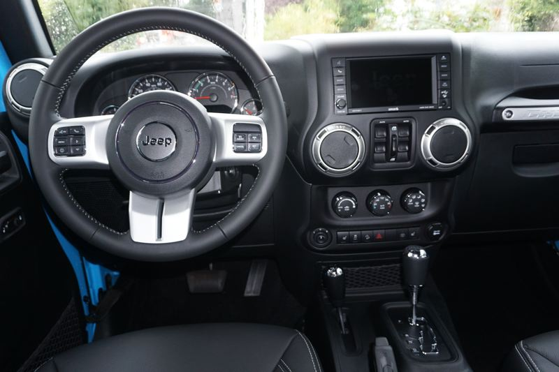 PORTLAND TRIBUNE: JEFF ZURSCHMEIDE - Inside, the Wrangler Unlimited gives you two rows of seating. In many trim levels, you'll enjoy heated front seats, leather, and a nice Uconnect infotainment system.