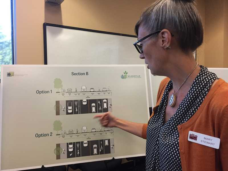 SPOKESMAN PHOTO: CLAIRE GREEN - Project consultant Mary Stewart walked attendees through the design process at the Sept. 11 open house.