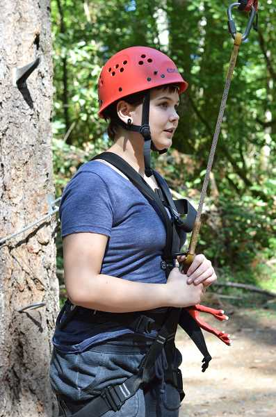 SPOKESMAN PHOTO: CLARA HOWELL - Sophomore Justine Jung waits for the go-ahead from Synergo employees to climb the above-ground element.