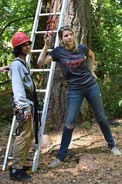 SPOKESMAN PHOTO: CLARA HOWELL - Junior Arya Farzin (left) and Lara Valachovic (right), a Synergo employee and Arts and Technology graduate, makes sure peers are ready to belay Farzin when he starts this challenge course.