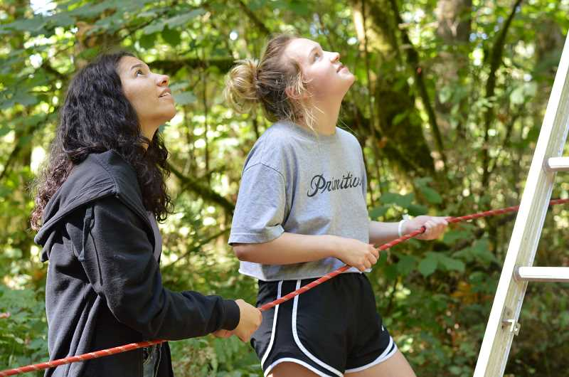 SPOKESMAN PHOTO: CLARA HOWELL - Juniors Trinity Dixon (left) and Fiona Davis (right) are ready with the rope, releasing it just enough to help the person walking on the high wire remain comfortable and stable.