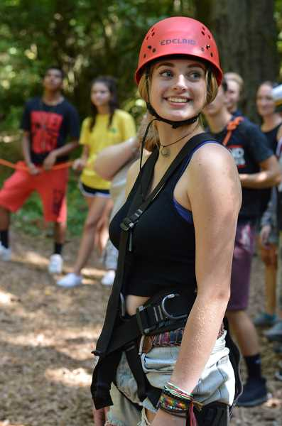 SPOKESMAN PHOTO: CLARA HOWELL - Senior Paloma Pahle gets harnessed in and ready to take her turn walking across the high wire.