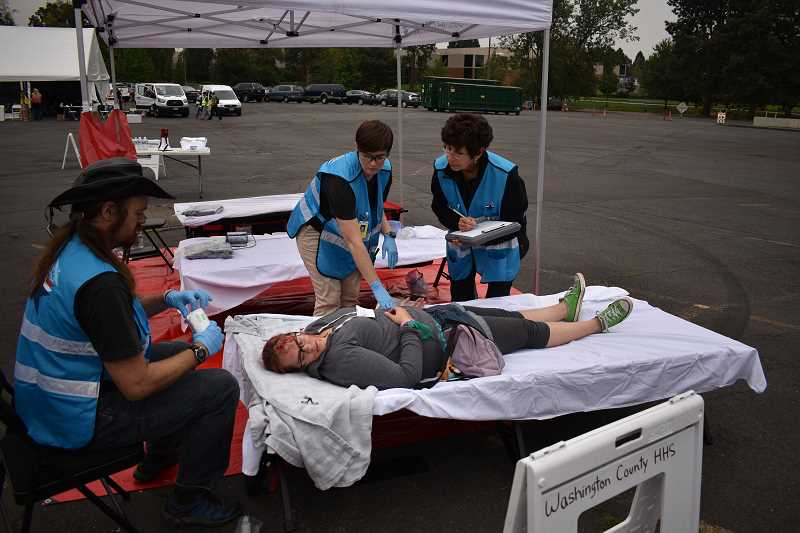 PHOTOS COURTESY OF THE CITY OF BEAVERTON - Community volunteers played the role of disaster victims during the emergency preparedness exercise.
