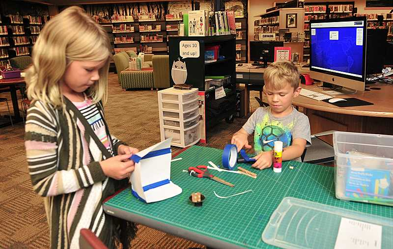 Evi and Oliver Hackbarth work on some creations in the makerspace — an area library staff and foundation members have targeted for improvement.