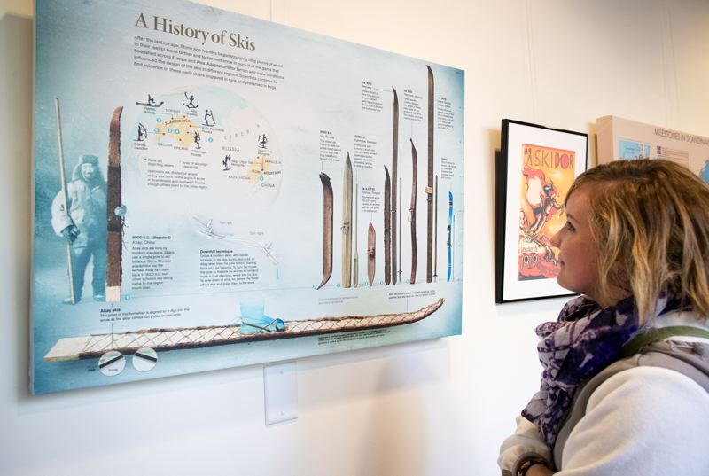 TIMES PHOTO: JAIME VALDEZ - Courtney Wright, visiting Nordia House from Wisconsin, looks at a panel in its new exhibit 'Winter Comes: Oregon's Nordic Ski History' on the evolution of skis from the prehistoric to the present-day.