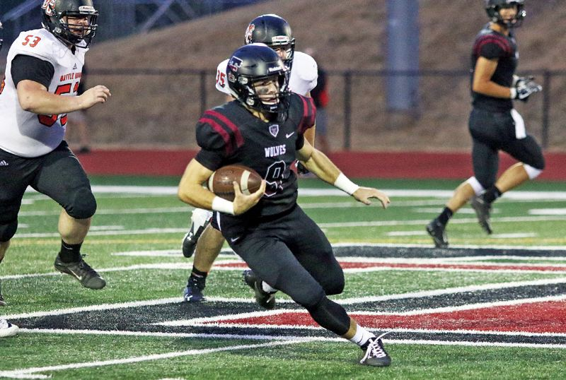 PAMPLIN MEDIA GROUP PHOTO: DAN BROOD - Tualatin quarterback Kyle Dernedde and the Timberwolves will try to get to 2-0 in Three Rivers League play this week when they host West Linn at 7 p.m. Friday.
