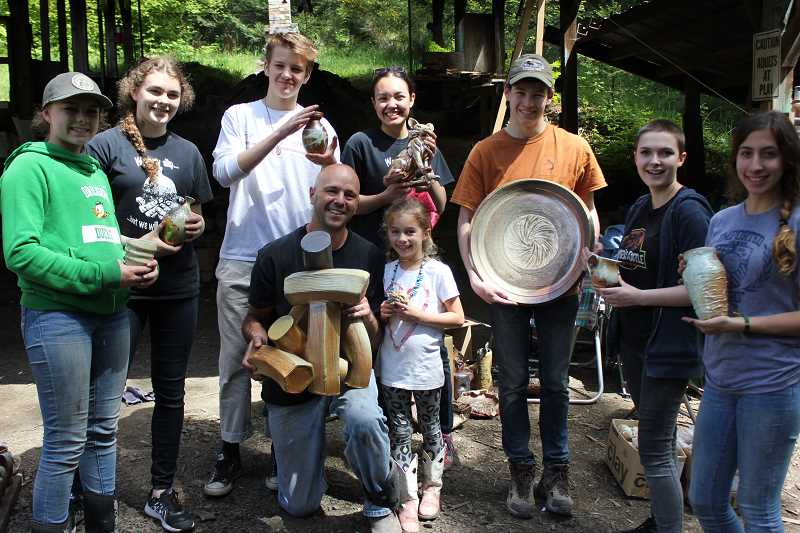 PHOTO COURTESY OF MICHAEL HELLE - Lakeridge ceramics teacher Michael Helle and students show off their newly wood-fired ceramics pieces during a recent visit to the East Creek kiln in Willamina.