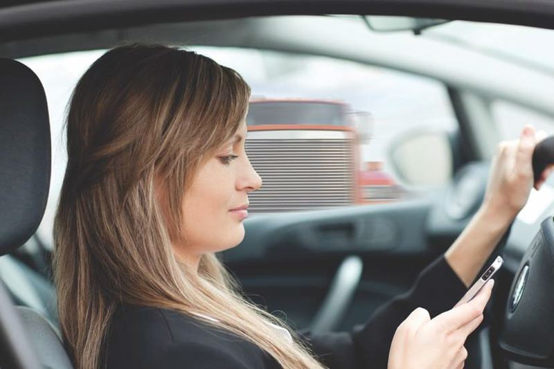 OREGON DEPARTMENT OF TRANSPORTATION - A stock photo that was used by ODOT's Traffic Safety Division for a public education poster on texting and driving