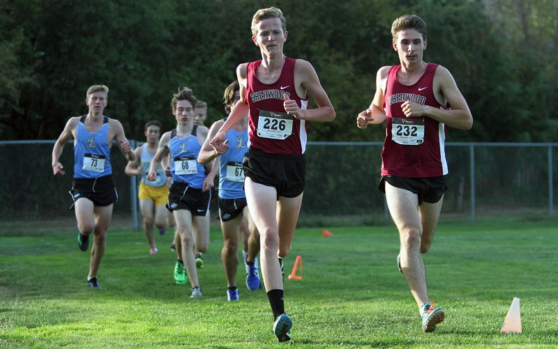 PAMPLIN MEDIA GROUP: MILES VANCE - Henry Giles (226) and Josh Qualio helped lead the way for the Sherwood boys cross country team at last week's meet.