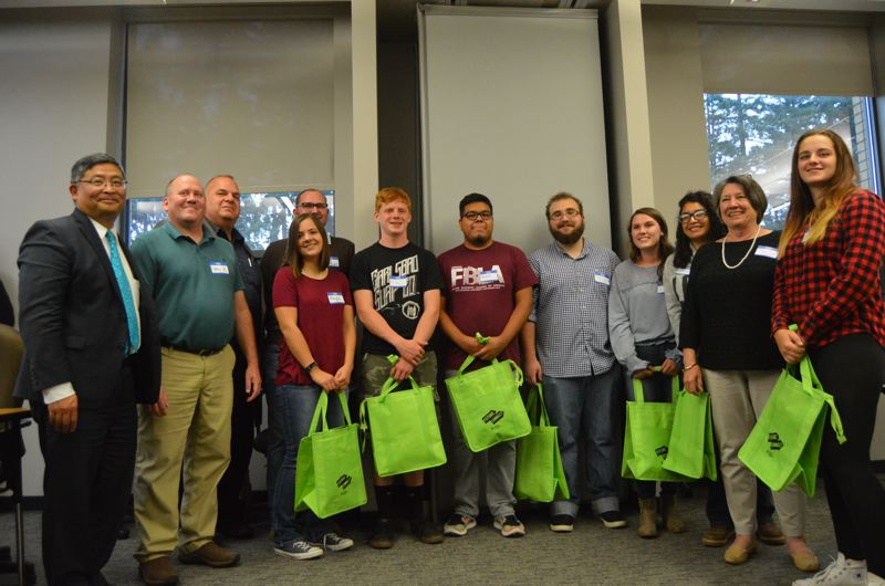 SPOTLIGHT PHOTO: COURTNEY VAUGHN - Future Connect scholarship recipients and PCC staff meet Tuesday evening in Scappoose. Eight students were awarded scholarships this year to attend PCC.