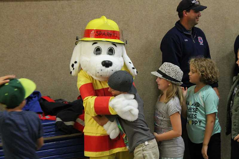 PIONEER PHOTO: CONNER WILLIAMS - Sparky the Fire Dog gives out hugs during last year's Fire Prevention Week.