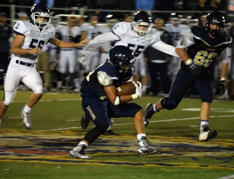 TANNER RUSS - Junior Tristan Ramirez would have seven carries for 78 yards in Canby's loss to Lake Oswego at home.