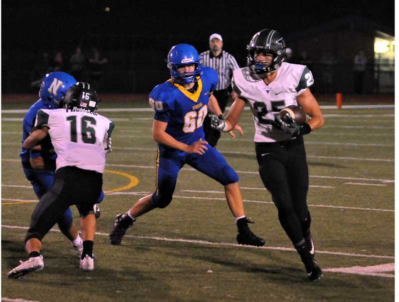 SETH GORDON - Braden Lenzy turns the corner against the Newberg defense during Tigard's 21-6 win Friday night at Loran Douglas Field.