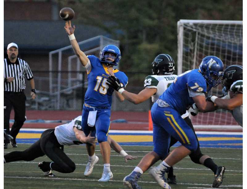 SETH GORDON - Quarterback Garrett Myers launches a pass during Newberg's 21-6 home loss to Tigard Friday night.