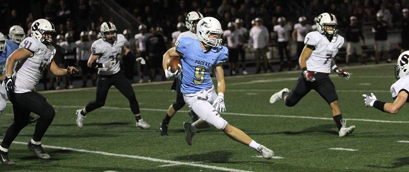 REVIEW PHOTO: MILES VANCE - Lakeridge's Will Scadden makes a cut during his team's 49-42 overtime win over Sherwood on Friday at Lakeridge High School.