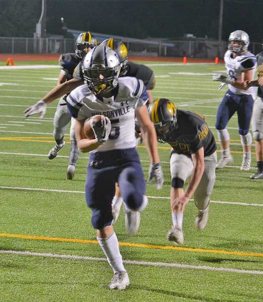 JAKE MCNEAL - Wilsonville junior running back Cooper Mootz runs for one of his four touchdowns.