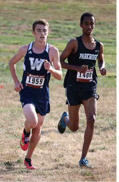 JIM BESEDA - Nicholas Whitaker took first place in the meet in Canby, and the Wilsonville boys and girls teams took first.