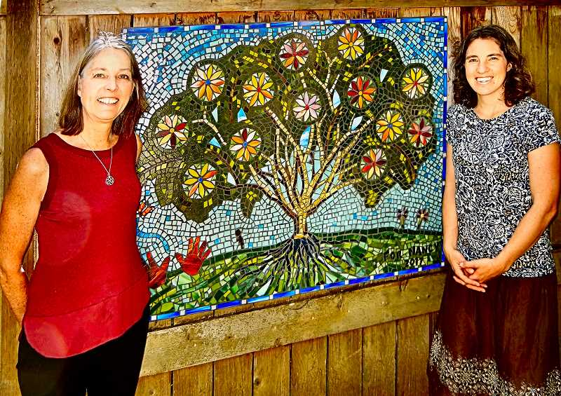 ELIZABETH USSHER GROFF - Nancy Pribnow, at left, retiring Head of School of the Whole Child Montessori Center, will be succeeded by Anna Langstaff, shown at right. This tree mosaic was a retirement gift to Nancy from the community of Whole Child.