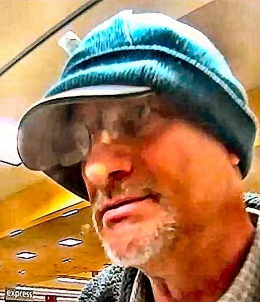 "FBI-PROVIDED SURVEILLANCE PHOTO - This man was called the ""Double Hat Bandit"" because of his habit of wearing a stocking cap over a baseball cap in his bank robberies. He hit the Woodstock Wells Fargo branch twice this year."