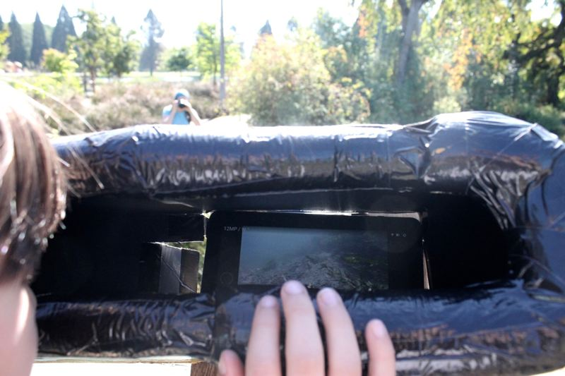 TRIBUNE PHOTO: LYNDSEY HEWITT - A camera is set up underwater so people can see activity in the creek.