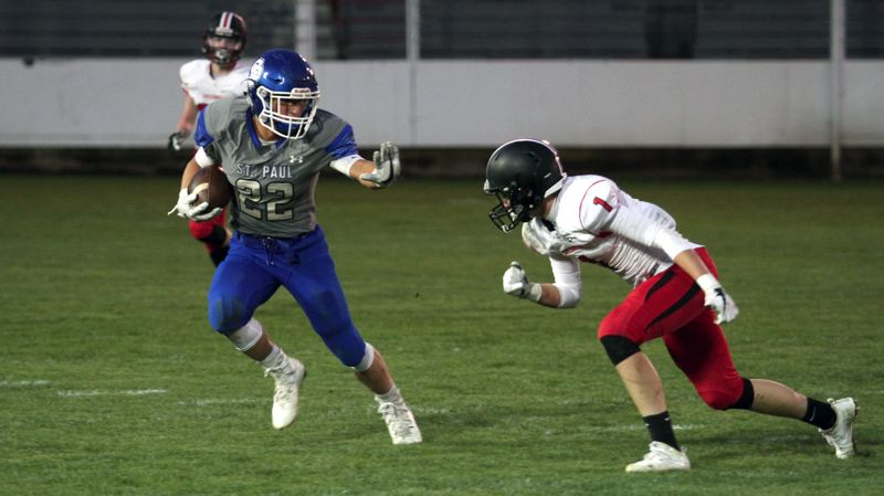 INDEPENDENT PHOTO: PHIL HAWKINS - St. Paul running back Justin Herberger takes off on a 69-yard touchdown run during his team's 53-7 win over Creswell on Friday night.