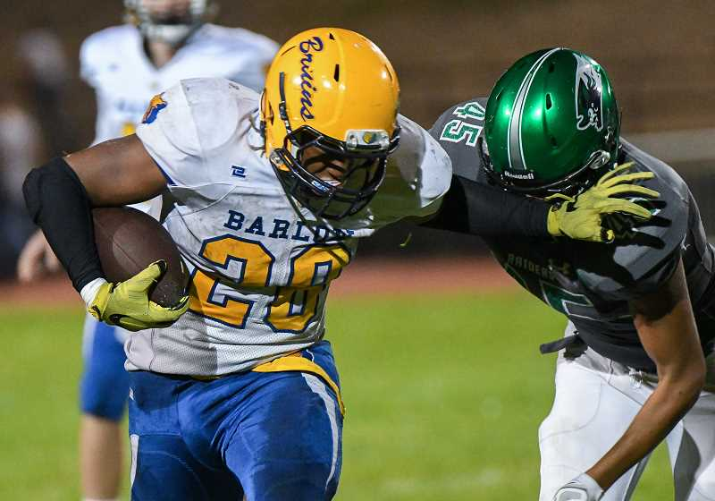 OUTLOOK PHOTO: JOSH KULLA - Barlow High School running back Jobadiah Malary runs the ball during the Bruins' 57-20 win over Reynolds last Friday in Mt. Hood Conference prep football.