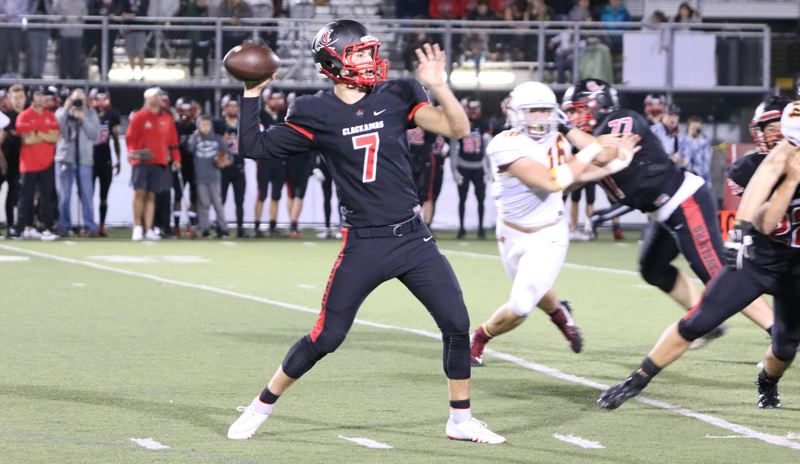 REVIEW PHOTO: JIM BESEDA - Clackamas quarterback Mitchell Modjeski gets ready to throw a pass during his team's 40-0 home win over Central Catholic on Friday night.