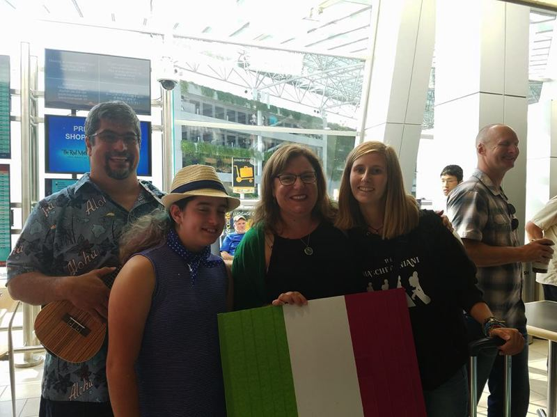 SUBMITTED PHOTOS - Anthony (from left), Kinsey and Lisa Sarmiento welcome Gaia Giordani from Italy as she arrives at the Portland International Airport to attend Milwaukie High School.